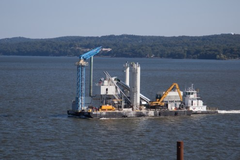 September 19, 2014 - of the project's floating concrete batch plants moving across the project site.