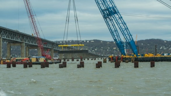 April 24, 2015 - One of the largest approach span pile caps on the project is carefully placed onto a group of foundation piles by the I Lift NY super crane.