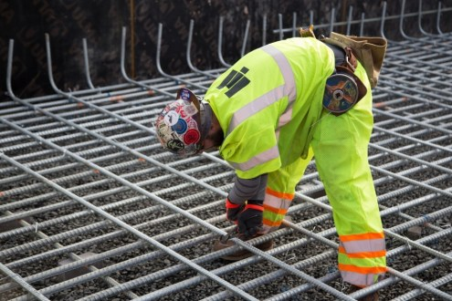 January 20, 2015 - Rebar is secured by an iron worker, who ties the galvanized steel where it intersects.