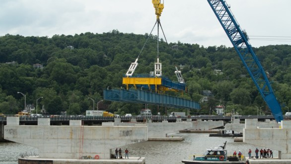 June 17, 2015 - A procession of concrete piers welcome the new bridge's first steel girder assembly.