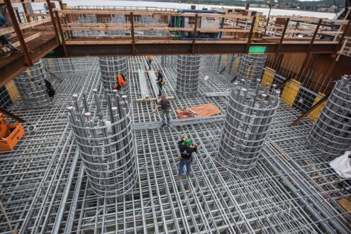June 4, 2015 - Ironworkers arrange layer upon layer of steel reinforcements in the new bridge's foundations.