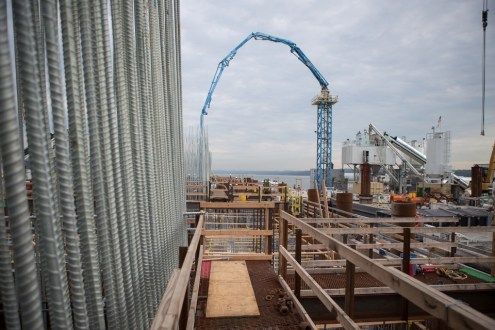June 30, 2015 - One of the project's floating batch plants delivers a steady supply of concrete to the main span foundations.