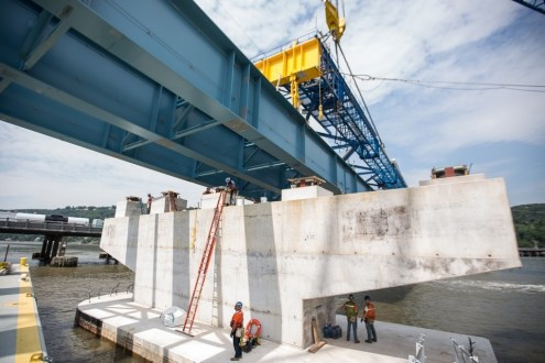 June 30, 2015 - The I Lift NY super crane places an immense steel girder assembly on the new bridge's concrete piers.