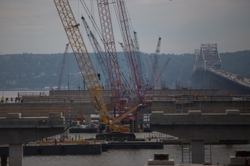 July 21, 2015 - The project's floating cranes are helping create even more piers for the new twin spans.