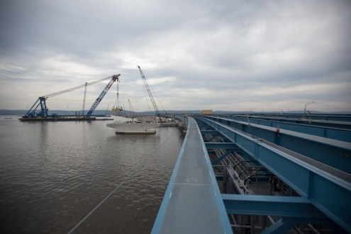 July 21, 2015 - The I Lift NY super crane will install over 100,000 tons of steel girders for the new bridge.