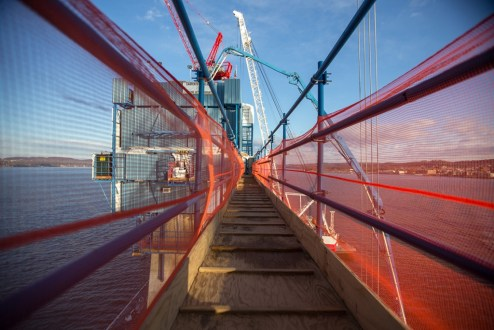 December 3, 2015 - A temporary path connects two of the main span towers, providing access for crew members.