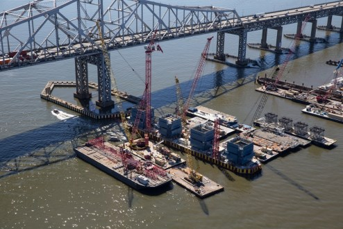 September, 2015 - The new bridge's 419-foot towers begin construction on football-field-length foundations.