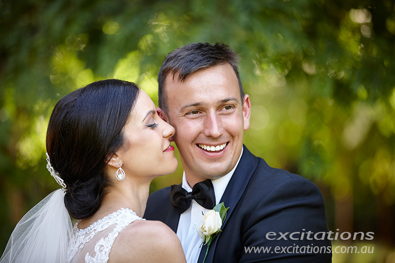 Close up of bride and groom in Chislett's garden at Gol Gol. Wedding photos by Excitations Mildura photographers.