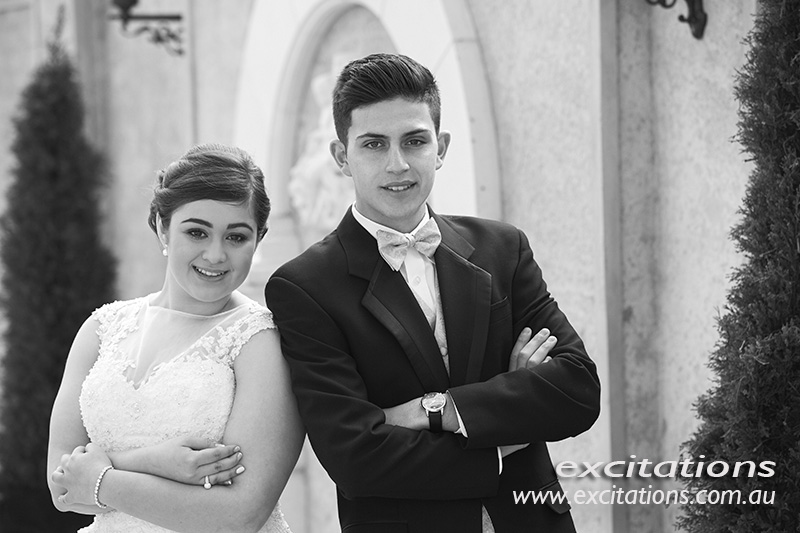 Half length, black and white portrait of debutante and her partner.
