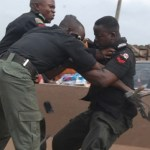 Three Nigeria Police officers fighting