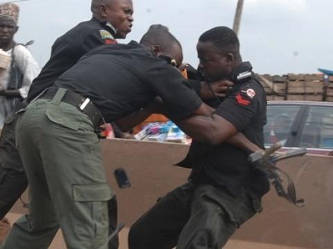 Three Nigeria Police officers fighting