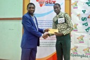 Presenting Cash Prize to the Best Speller by Afristar International