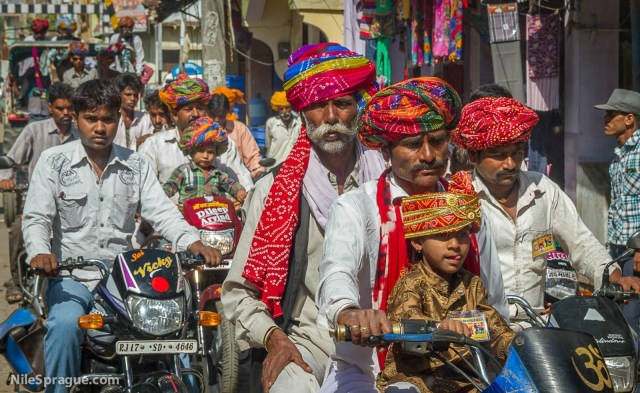 Men and Boys with colorful turbans riding motorcycles, Chau Mahla District, Rajasthan, India.