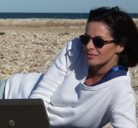 image of Ally, blogger and social media addict working with the laptop at the beach