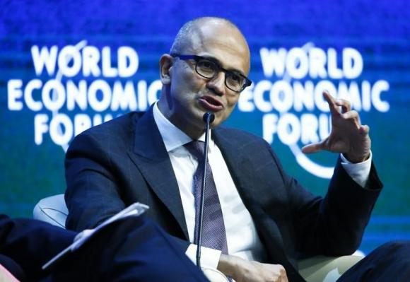 "Nadella, CEO of Microsoft Corporation, gestures during the session ""The Future of the Digital Economy"" in the Swiss mountain resort of Davos"