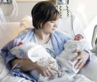 Flood babies couldn't wait, Vicki Krenz holds twins Brennen, left, and Lidia in her hospital room Friday at Innovis Health in Fargo. Carrie Snyder / The Forum