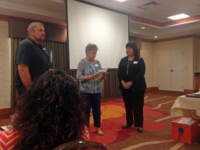 New Board Members - Gloria swearing in Thomas Nayman, Gena Doniphan
