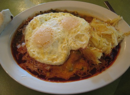 Breakfast Enchiladas with two fried eggs