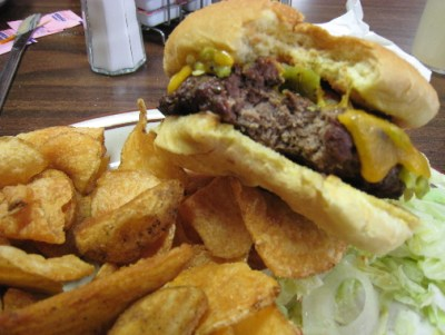 Green chile cheeseburger with homemade potato chips and fries