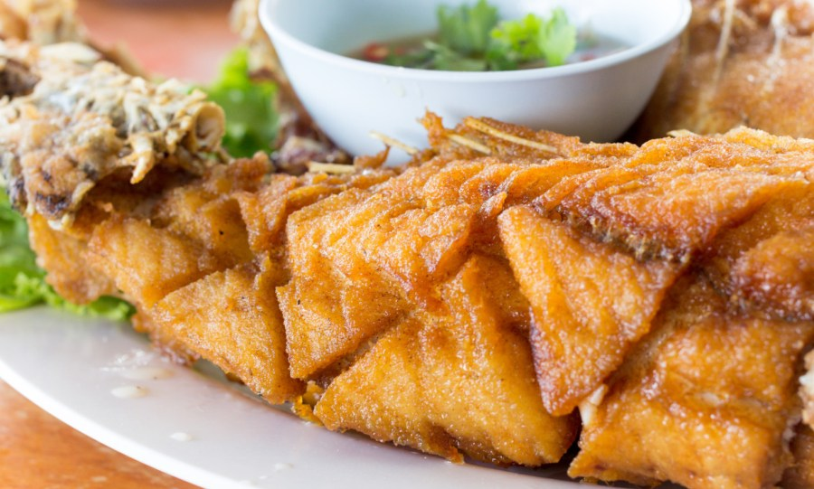 score marks visible on fish - Fried seafish with Thai style sauce