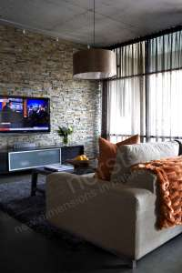 How to Install a TV on a Stacked Stone Wall - Norstone Blog