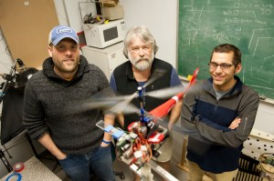 Anthony Westphal, left, a postdoctoral candidate studying marine and environmental sciences, Joseph Ayers, center, Professor of Neurophysiology and Behavior Biomimetics, and Dan Blustein, right, a doctoral student in biology, test autonomous flight components using a radio controlled helicopter as part of the RoboBees project, which aims to develop miniature, coordinated flying robots.
