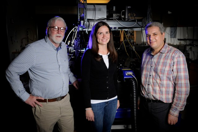 Paul Champion, professor and chair, Department of Physics, left, Bridget Salna, physics PhD candidate, and Research Associate Abdelkrim Benabbas, pose for a portrait in the Egan Research building at Northeastern University