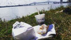Cafe du Monde beignets and a frozen cafe au lait, best ordered to go and enjoyed on the bank of the Mississippi