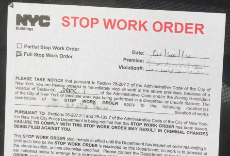A New York City Stop Work order is posted at the site of an illegal conversion.