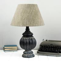 black aged round table lamp by the orchard