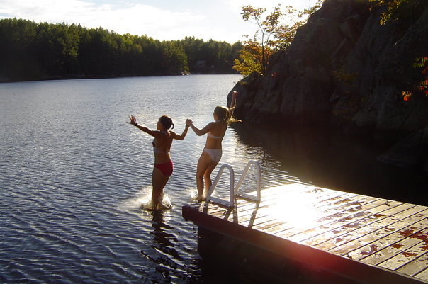 Jumping off dock at cottage