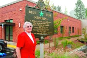 Kathryn Israelson with Fairview memorial plaque
