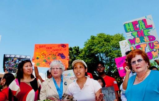 Garden organizer Jennifer Chu flanked on left by Congresswoman Grace Meng & State Senator , on right by