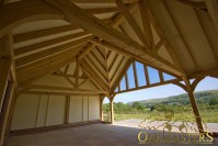 Detail of complex oak roof structure with exposed rafters ...
