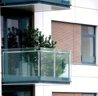 Railings on the balcony  stainless steel, wood or glass