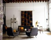 Living room with a sofa and an armchair upholstered in ...