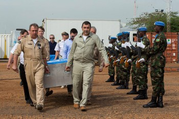 UN aircraft crew carrying the remains of three crew members to memorial service in Juba, South Sudan. They died when their helicopter came down near Bentiu, Unity State, on 26 August 2014 (Photo: JC McIlwaine, UNMISS).