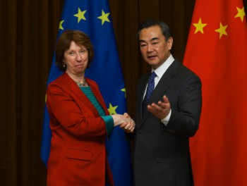 Chinese Foreign Minister Wang Yi shakes hands with Catherine Ashton during their talks in Beijing, April 27, 2013 (Photo: Xie Huanchi / Xinhua Press / Corbis).