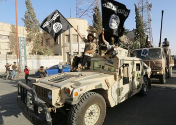 """ISIS fighters take part in a military parade along the streets of Syria's northern Raqqa province in June 2014. The fighters held the parade to celebrate their declaration of an Islamic """"caliphate"""" after the group captured territory in neighbouring Iraq."""