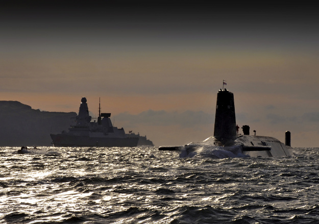 Nuclear submarine HMS Vanguard passes HMS Dragon as she returns to HMNB Clyde, Scotland.