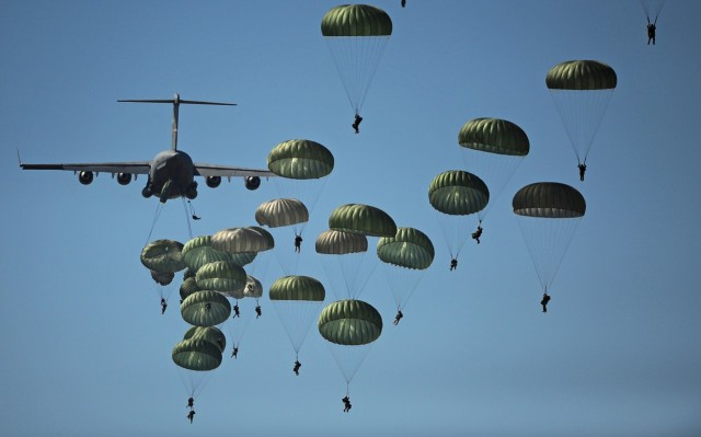 U.S. Army paratroopers from the 82nd Airborne Division descend to the ground after jumping out of a C-17 Globemaster III aircraft over drop zone Sicily during Joint Operations Access Exercise at Ft. Bragg, N.C. (Photo by A1c James Richardson, USAF).
