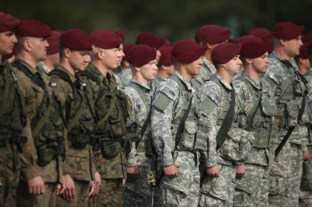 Members of the U.S. Army 173rd Airborne Brigade and a Polish paratrooper unit attend a welcome ceremony.