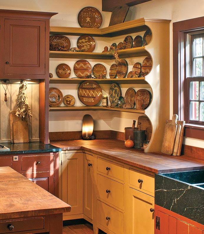8 ways design kitchen early house kitchen cabinets cincinnati Redware displayed on colonial inspired open shelves adds color and style to the kitchen in