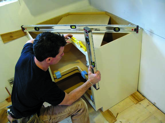 how to install kitchen cabinets installing kitchen cabinets It s important to ensure that the cabinets are level and plumb in all directions
