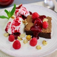Luscious Chocolate Brownies With Ice Cream and Raspberry Sauce