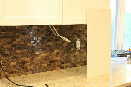 white kitchen brown backsplash