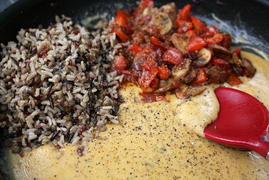 adding rice to cheese sauce