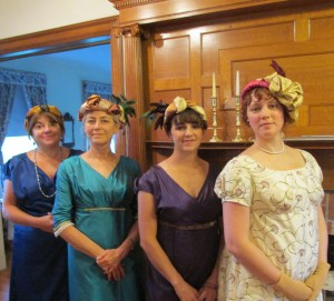 four ladies in regency evening finery with newly-made turbans