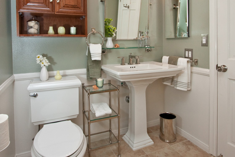 Four pedestal sinks in four very different bathrooms one