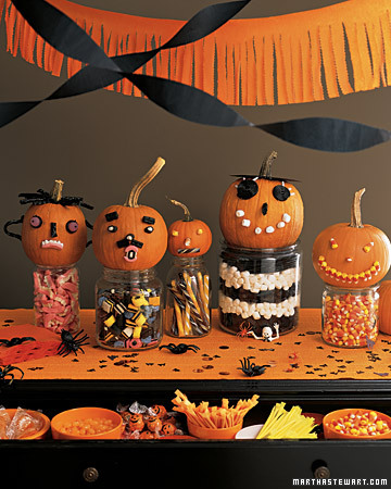halloween decos with pumpkins on candy filled jars